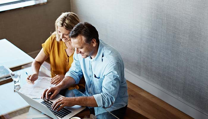 Couple looking for superannuation contributions