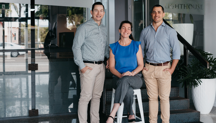 Lighthouse Financial Advisers owners standing in office